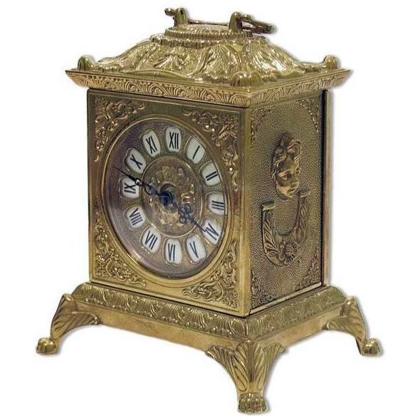 Часы для камина золотистого цвета из латуни