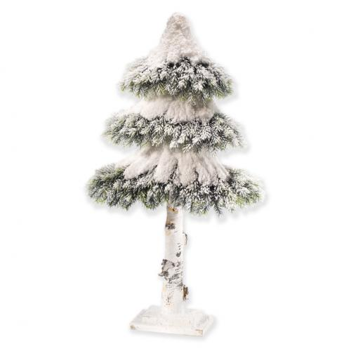 Невысокая новогодняя елка с заснеженными ветками - фото