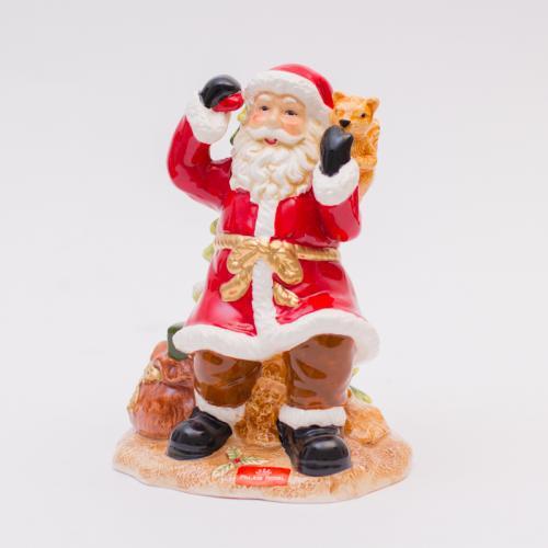 Яркая статуэтка Деда Мороза из фарфора - фото