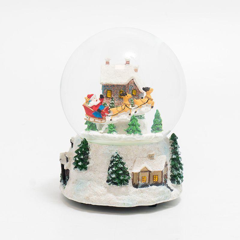 "Музыкальная шкатулка-шар ""Санта на оленях возле домика"""