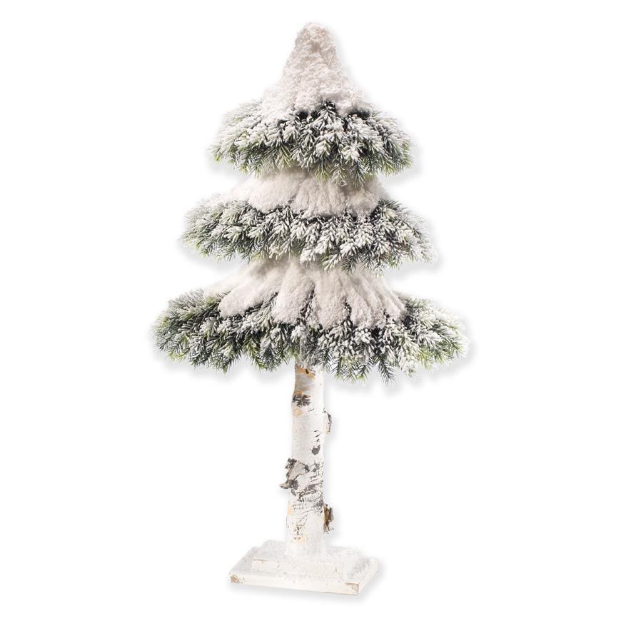 Невысокая новогодняя елка с заснеженными ветками