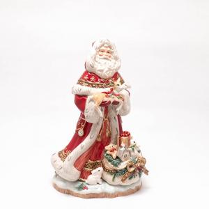 """Статуэтка """"Дед Мороз с оленёнком на руках"""""""